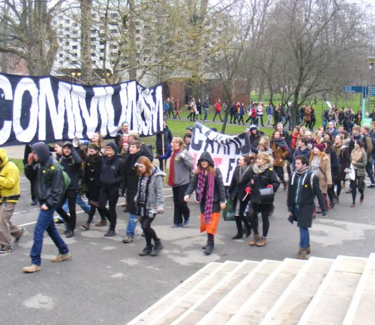Students march through the campus their main banner displaying their hostility to capitalism and privatisation