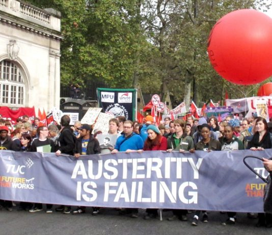 One of the lead banners on the TUC march in London last October 26 – four months later workers are more determined than ever to get rid of the coalition