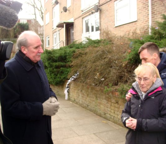 Tenant Joan Elsby and her son Kevin with Crown Properties executive Nick Wood, BBC cameras looking on.