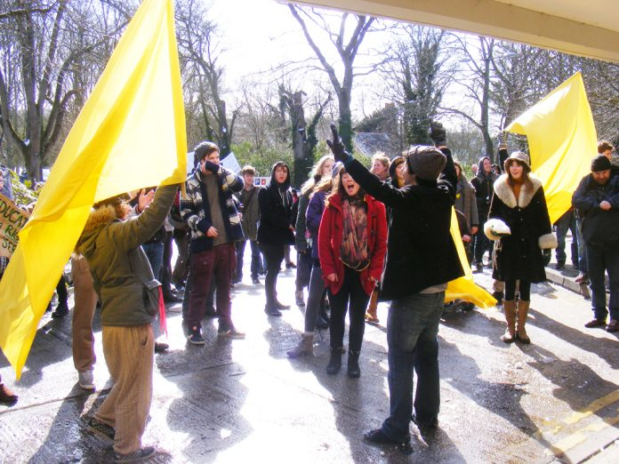 Students, teachers and staff holding a 'noise demonstration' during yesterday's march against privatisation