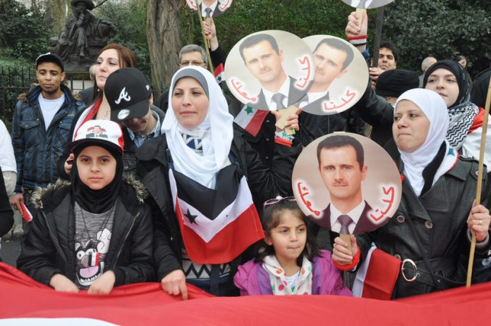 Syrian women and children supporting President Assad outside the Syrian Embassy last year