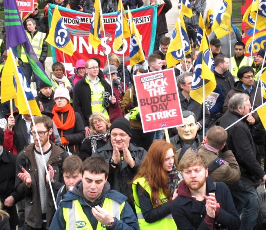 Striking civil servants applauding a call from the Prison Officers Association for a general strike