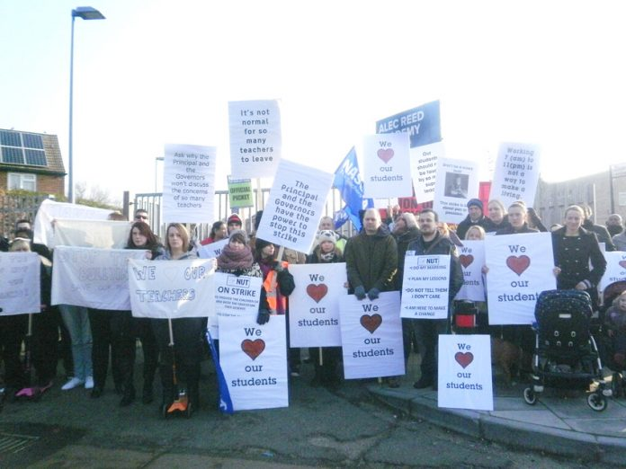 Picket line of parents, teachers and pupils at the Alec Reed Academy in Northolt, during their strike over bullying and harassment