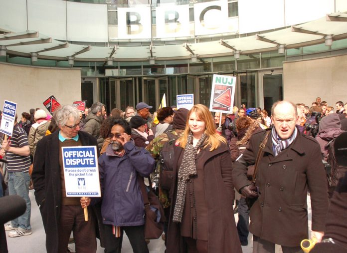 NUJ general secretary Michelle Stanistreet (second from right), and BECTU general secretary GERRY MORRISSEY (right) outside Broadcasting House with BBC journalists and technicians at noon yesterday at the beginning of a 12-hour national strike