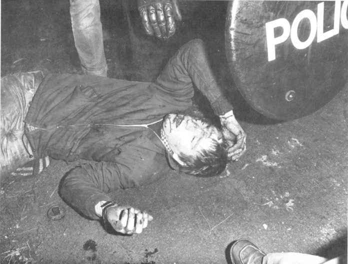 Thatcher's law at work – miner lies badly injured at Maltby in September 1984. He had been battered by police forces sent up from London to attack miners picket lines