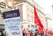 Workers on the TUC march last October making it clear they want a general strike now!