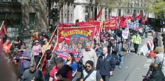 A section of the May Day march in London making its way to Trafalgar Square yesterday afternoon