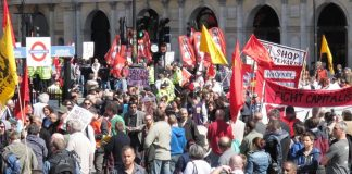 The London May Day march arrives in Trafalgar Square for the rally