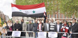 Syrians demonstrate outside the US embassy in London in support of President Assad against the imperialist support for terrorist acts in Syria