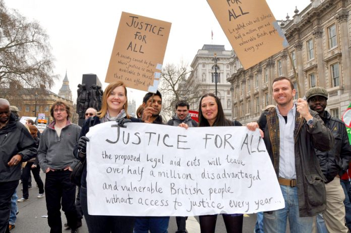 Marchers with their warning on the March 2011 TUC demonstration against the Coalition's cuts