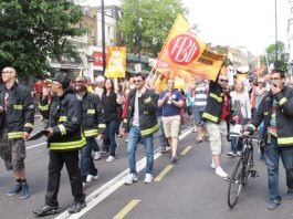 Kingsland firefighters at the head of their march in a buoyant and determined mood