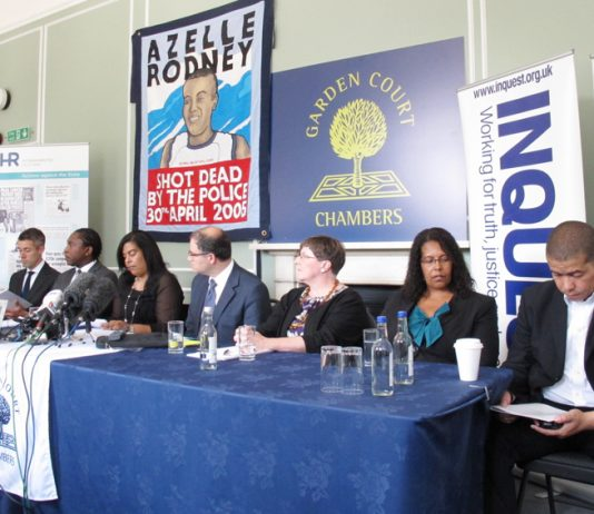 Mother of Azelle Rodney, SUSAN ALEXANDER, (beneath her campaign banner) addressing yesterday's press conference
