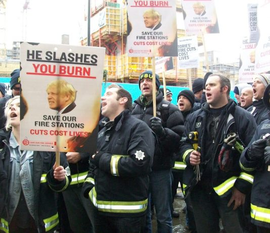 Firefighters lobby the London Fire Authority on February 11 demanding 'No cuts'
