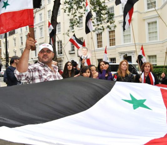 Syrian workers and youth picket the Saudi embassy in London in support of President Assad