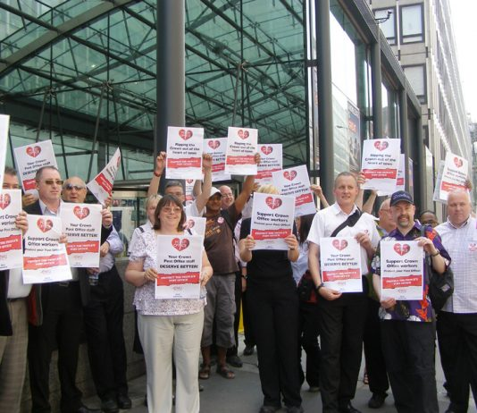Post Office workers rally yesterday afternoon in Westminster while striking to keep Crown Post Offices open