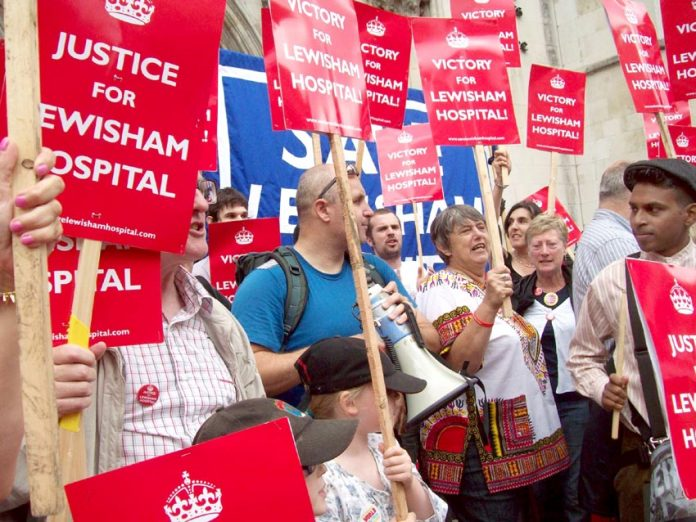 Campaigners to keep Lewisham Hospital open celebrate the High Court's decision that Health Secretary Hunt was breaking the law with his decision to run down the A&E and other departments in the hospital