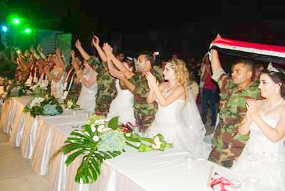 Mass wedding ceremony for 15 soldiers of the Syrian Arab Army in Lattakia province