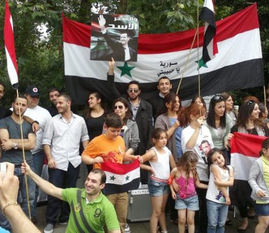 Syrians in London demonstrating in support of President Assad – Hezbollah is ready to send its fighters to defeat the imperialist-backed terrorists