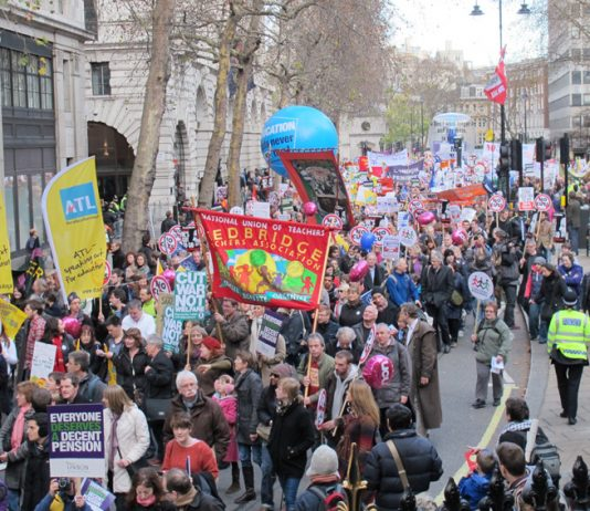 Teachers march during a national public sector strike in defence of pensions