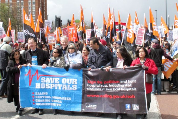 Tens of thousands marched in April against the planned closure of four west London A&Es. Ex-Labour Health Secretary Hewitt supports closing NHS hospitals and sending patients to India