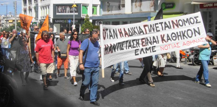 Teachers demonstrating through the streets of Nea Smirni, Athens. Banner reads 'When injustice becomes law, resistance is a duty'