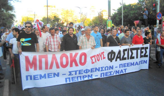 Seafarers with their union banner calling for a 'block to fascism' at the head of Thursday's march in Kokkinia, Athens