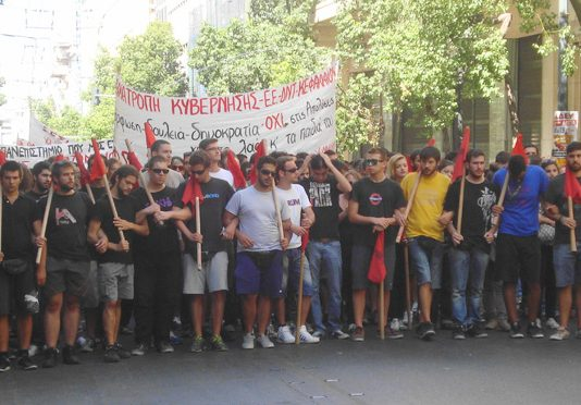 University students  marching in Greece – the banner reads 'Overthrow the government'