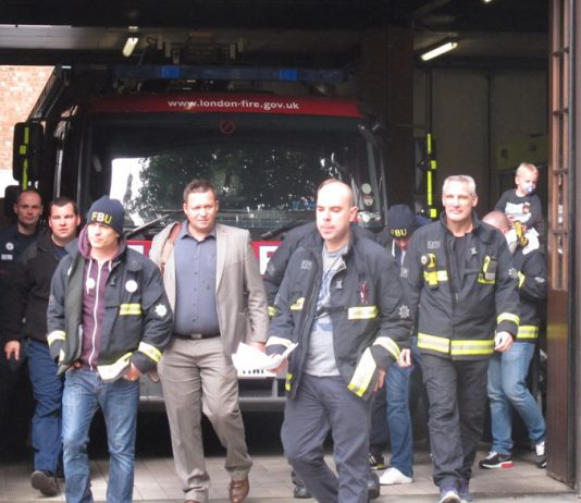 Firefighters walk out at Euston fire station