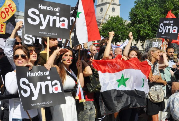 Demonstrators demanding 'Hands off Syria' after the demonstration in London on August 31