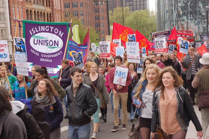 Young workers marching in London to defend the NHS on May 18 – are part of the movement of millions of workers who are ready to take action to defend their wages and jobs