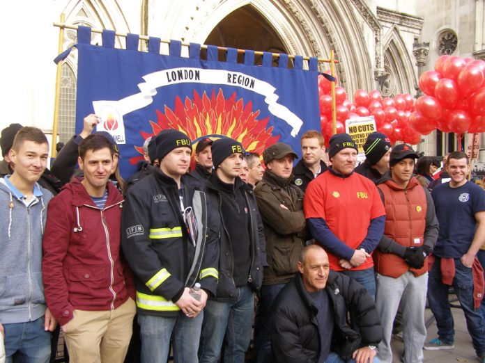 Part of the mass lobby of the law courts by 100 firefighters midday yesterday to stop Mayor Johnson's savage cuts