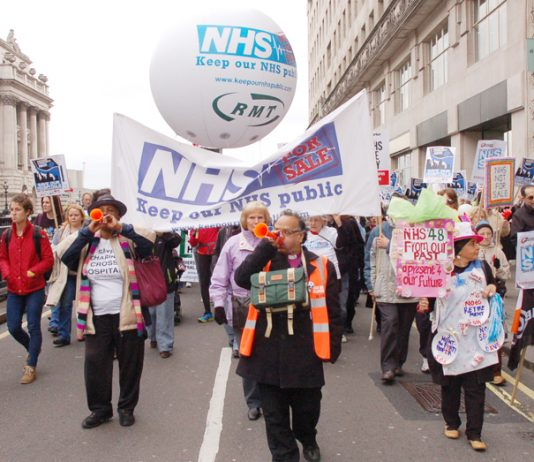 Marchers in London urging: defend the NHS and stop privatisation – the GMB is now fighting an attempt to privatise an elderly people's service contract in Cambridge which is being presented as a £1bn deal