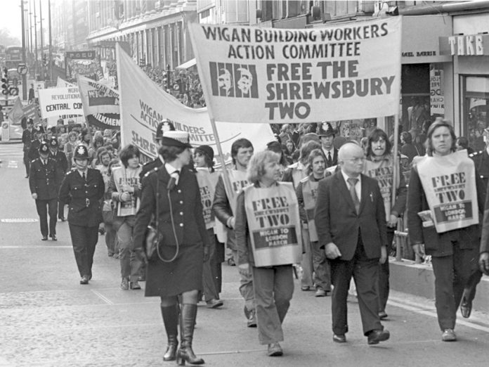WRP leader Gerry Healy leads the Wigan Builders Action Committee march through central London in February 1975 to free the Shrewsbury Two