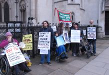 Campaigners outside the Royal Courts of Justice yesterday morning demanding 'Axe the Bedroom Tax'