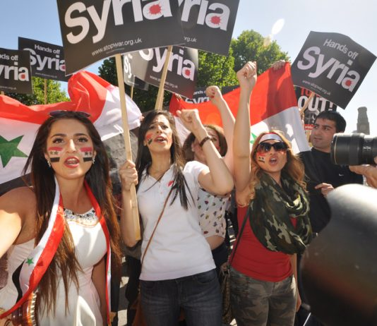 Syrian girls marching in London last August demand no imperialist intervention in Syria