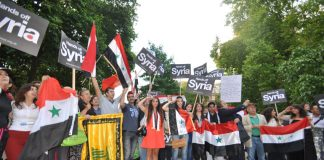 Syrians in London defend their country and picket the US embassy