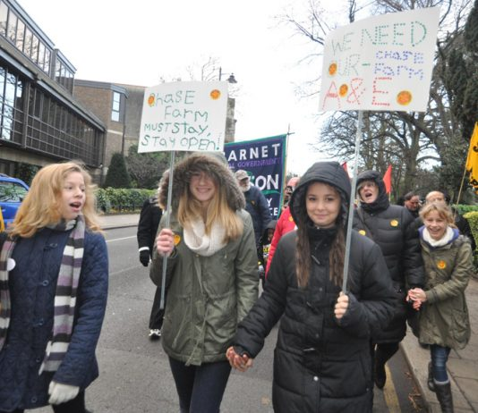 Youth join the march through Enfield Town on the day before the A&E at Chase Farm Hospital was closed last December