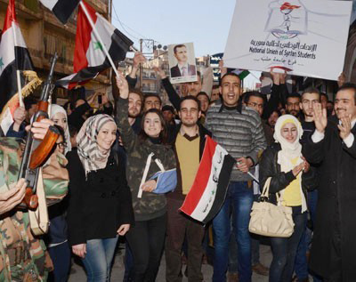 People of Aleppo  marching through the streets of the city on Tuesday to show their support for the Syrian Arab Army