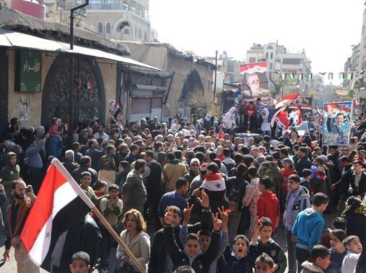 Section of the huge demonstration of Syrians in Deir Ezzor show their support for president Assad