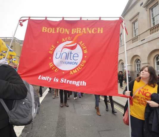 Unite council workers marching against wage freeze & public sector cuts