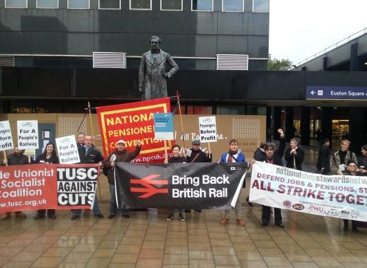 Trade unionists rally outside Euston Station demanding rail re-nationalisation – twenty years after it was privatised in 1993