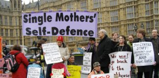 Demonstration in 2012 outside the House of Commons including mothers with children fighting against benefit cuts