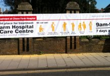 The new 30x6ft banner erected outside Chase Farm Hospital that replaces the 3x3ft sign that was there when a 2-year-old child was taken by his mother to what she thought was the A&E, only to find the door to the Urgent Care Centre was locked. The child di