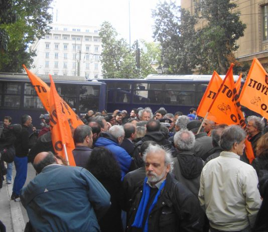 Greek riot police squads and buses block the road to demonstrating teachers last Thursday