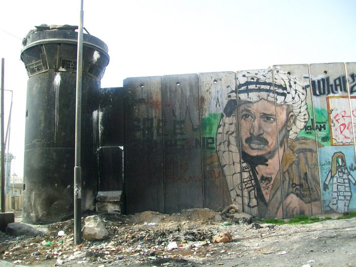 Portrait of Yasser Arafat on the Israeli separation wall