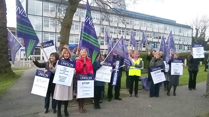 Medical secretaries demonstrate outside Crawley Hospital yesterday against outsourcing