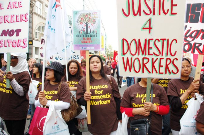 Domestic workers marching on May Day demanding proper job contracts