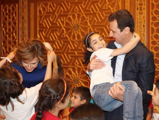Syrian president BASHAR AL-ASSAD and his wife ASMA receiving sons and daughters of martyrs on Martyrs' Day