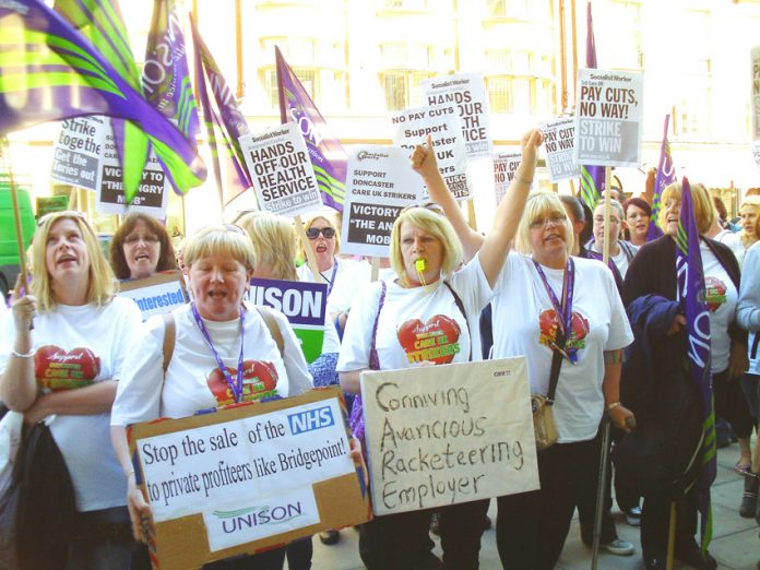 A busload of Care UK workers demonstrated on Wednesday outside Bridgepoint Capital private equity company that is seeking to slash their wages and jobs