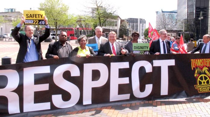 Teamsters union leader James Hoffa (centre) lobbies the National Express shareholders meeting in Birmingham along with Unite leader McCluskey